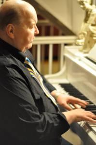Cring, enjoying his grand piano