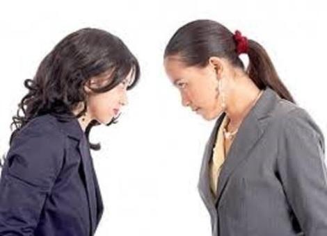 two girls talking bigger