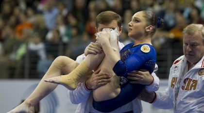 Gymnast with coach